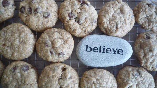 chocolate chip cookies with rock that says BELIEVE
