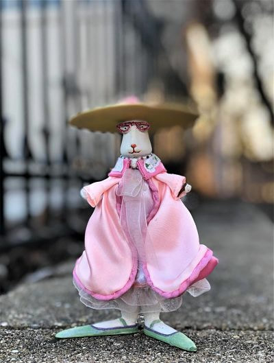 bunny in pink gown, large hat, glasses, very long feet