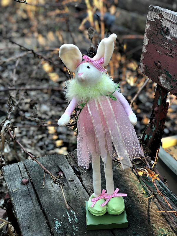 tall thin bunny in flowing pink dress, very long legs, big green shoes